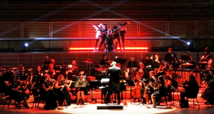 The Nu Deco Ensemble is conducted by co-founder Jacomo Bairos. (Photo by WorldRedEye.com).