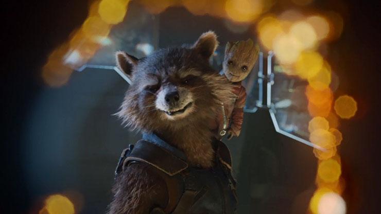 Rocket Raccoon (voice of Bradley Cooper), Baby Groot (voice of Vin Diesel)