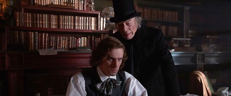 Dan Stevens as Charles Dickens and Christopher Plummer as Scrooge in
