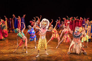 Gerald Caesar as Simba and company in THE LION KING North American Tour. Photo by Deen van Meer.