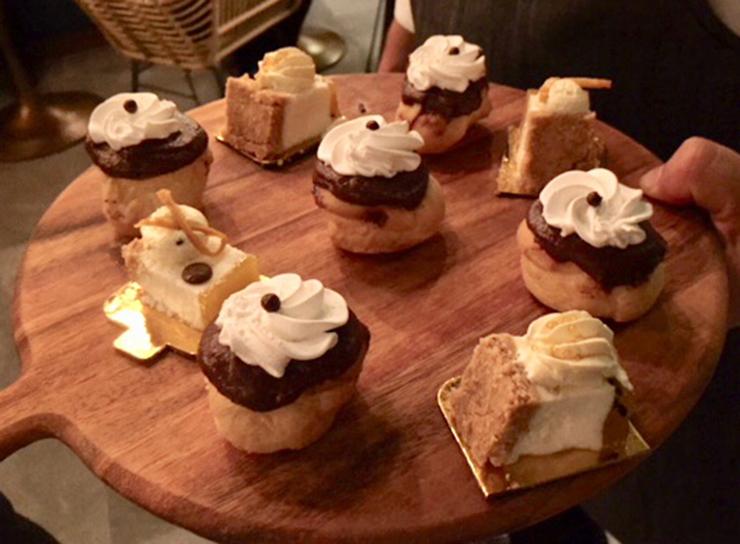 Assorted desserts including profiteroles.