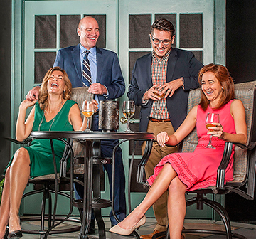 """Mia Matthews, Tom Wahl, Ryan Didato and Whitney Grace have a laugh in """"White Guy on the Bus"""" at GableStage. Photo by George Schiavone."""