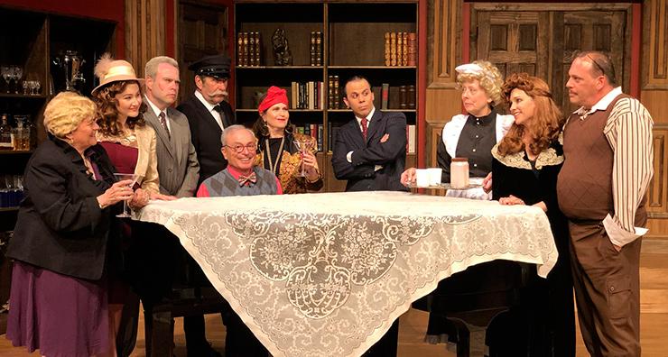 From left to right: JCAT actors Penny Landau (Marjorie), Shaila Sakona (Nikki), Brian Goldberg (O'Reilly), Sonny Levitt (Michael), Mark Firestone (Roger, sitting on piano stool), Peggy Linker (Bernice), Lito Becerra (Eddie), Debbie Bekefi (Helsa), Linda Drozdow (Elsa)  and director John Ferry (Ken) star in
