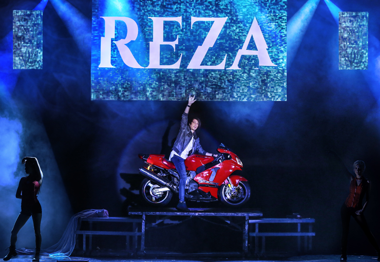 Reza magically appears on a motorcycle in his show