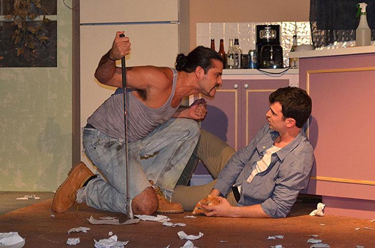 Lee (Christopher Millan) backs Austin (Tyler Grimes) into a corner in Main Street Players' production of True West. Photo: Dennis Lyzniak.