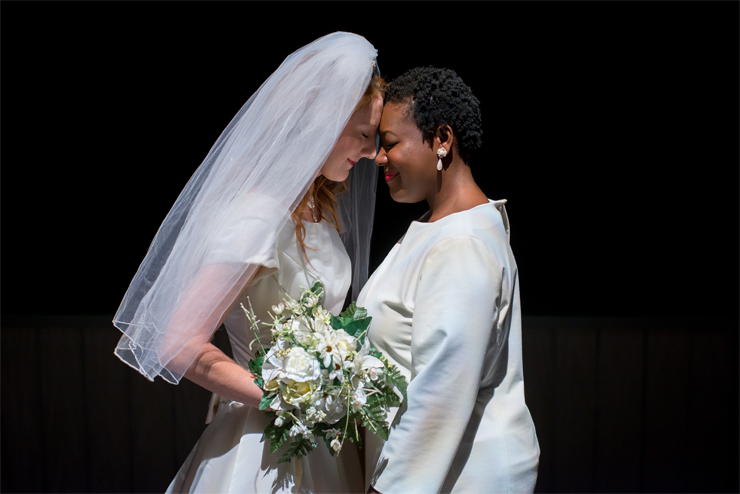 Jen (Lexi Langs) and Macy (Stephon Duncan) share an intimate moment as a married couple in