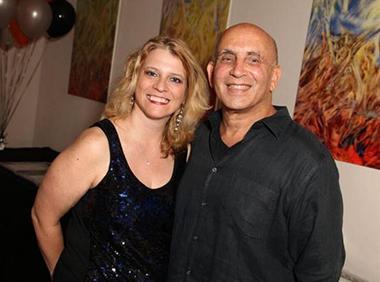 Michelle F. Solomon, miamiartzine.com editor and Harvey J. Burstein, publisher of miamiartzine.com at the 10th anniversary party.