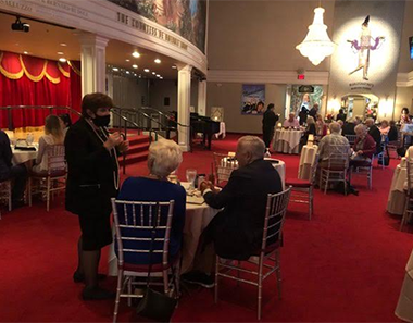 From left: Marilyn Wick (wearing mask on far left) greets her patrons and practices social distancing between tables at the Wick Theatre dinner cabaret show on June 6.