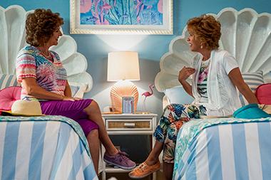 Annie Mumolo and Kristen Wiig in a scene from