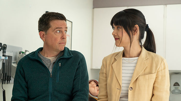 Ed Helms and Patti Harrison in a scene from