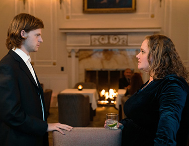 Lucas Hedges as Malcolm Price and Danielle Macdonald as Madeleine in