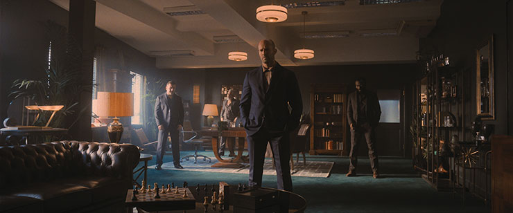 Cameron Jack as Brendan, Darrell D'Silva as Mike, Jason Statham as H, and Babs Olusanmokun as Moggy in director Guy Ritchie's