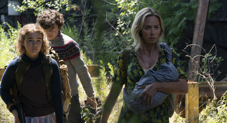 Millicent Simmonds as Regan Abbott, Noah Jupe as Marcus Abbott and Emily Blunt as Evelyn Abbott in a scene from