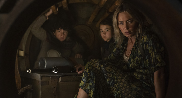 Noah Jupe as Marcus Abbott, Millicent Simmonds as Regan Abbott and Emily Blunt as Evelyn Abbott in a scene from