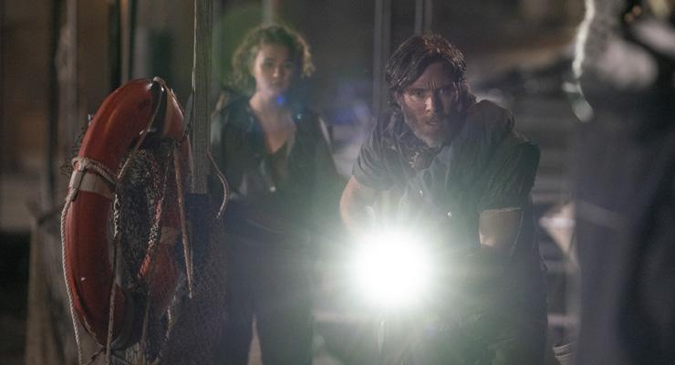 Millicent Simmonds as Regan Abbott and Cillian Murphy as Emmett in a scene from
