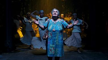 Olga Merediz (center) as Abuela Claudia in a scene from