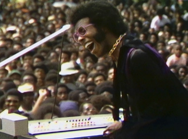 """Sly Stone performing at the Harlem Cultural Festival in 1969, featured in the documentary """"Summer of Soul (…Or, When the Revolution Could Not Be Televised)."""" (Searchlight Pictures)"""