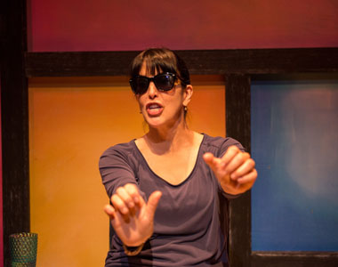 Elena Maria Garcia plays more than 20 characters in ¡Fuácata! or A Latina's Guide to Surviving the Universe' now at Actors' Playhouse at the Miracle Mile Theatre. (Photo by Justin Namon)